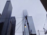 Three WTC nearing completion in the fog.