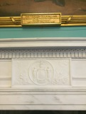 Relief of a NYS seal in the molding of the mantlepiece.